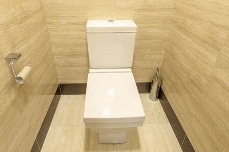 contemporary interior: The toilet seat lid open in a new toilet