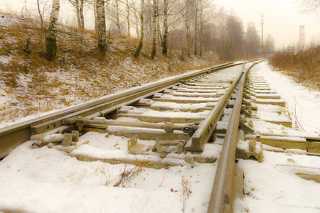 railroad tracks in the snow in the winter Stock Photo