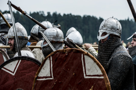Russia, Kimry, July 28, 2018, reconstruction of the medieval battle. warriors in armor festival of ethnical culture on the Volga Editorial