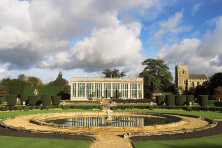 Gardens, orangery, and church at Belton House, England. Stock Photo