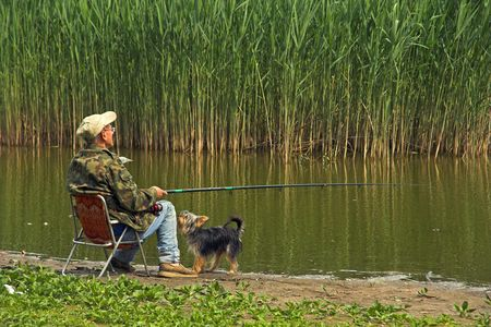 Patient angler and not so patient dog.