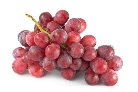 Red grapes isolated on white.