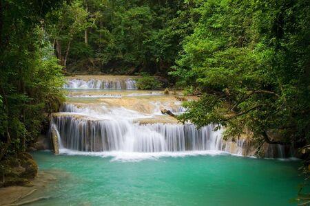 Mountain stream in tropical forest, Erawan National Park, Thailand. photo