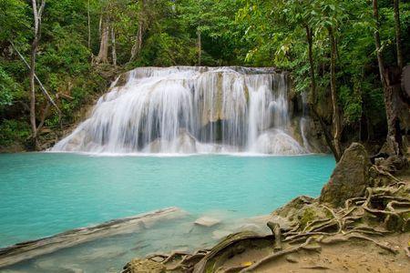 kanchanaburi: Waterfall with natural swimming pool, Kanchanaburi Province, Thailand. Stock Photo