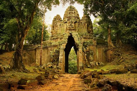the architecture is ancient: West gate to Angkor Thom, Cambodia.