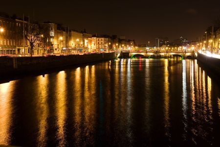 historical reflections: Dublin by night, view over the river Liffey. Stock Photo