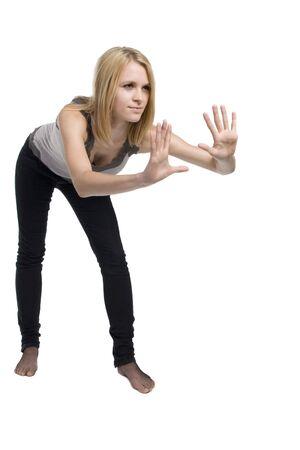 rearrange: Young woman pushing something aside, isolated on white. Stock Photo