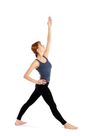 trikonasana: Woman in opening pose for yoga exercise called  Pavritta Trikonasana, isolated on white background.