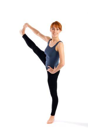 utthita: Young fit woman doing yoga exercise called Utthita Hasta Padangusthasana, isolated on white background.