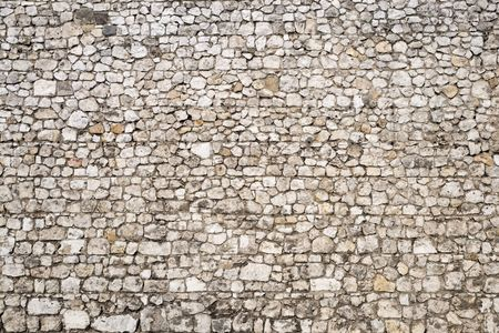 tiled wall: Old stone wall background of the medieval castle.