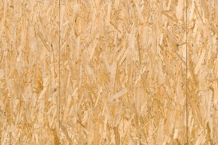flattened: Flattened wooden shavings slab background.