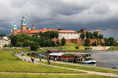 heritage protection: The Wawel Royal Castle in Cracow, Poland built in 14th at the behest of Casimir III the Great, rebuilt by Jogaila and Jadwiga of Poland. On the first plan Vistula river. Stock Photo