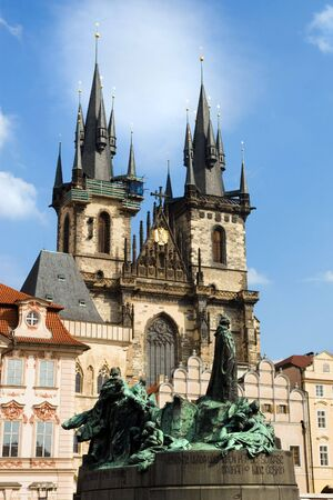 tyn: Church of Our Lady before Tyn and Jan Hus Statue in Prague Old Town, Czech Republic. Stock Photo