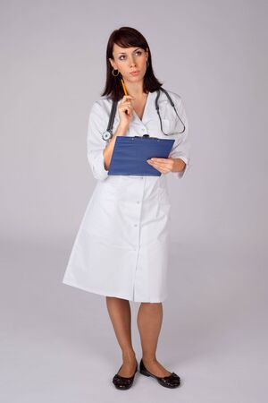 Young confident female doctor in thoughtful pose ready for medical examination. Stock Photo - 6268513
