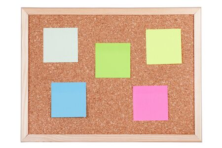 annoucement: Corkboard with empty coloured notes, isolated on white background.