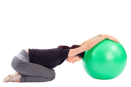 Young woman working out with gym ball, isolated on white. photo