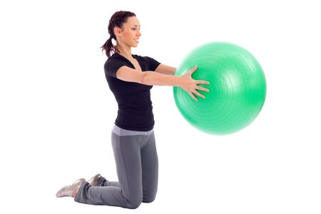 Young woman working out with gym ball, isolated on white background. Stock Photo - 6310762