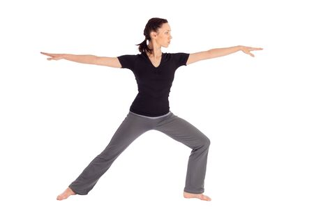 sanskrit: Young fit woman doing yoga exercise called Warrior (Sanskrit name: Virabhadrasana), isolated on white background.