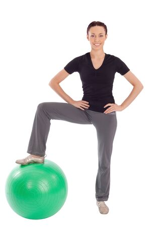 Young fit smiling pretty woman with gym ball, isolated on white background. Stock Photo - 6358301