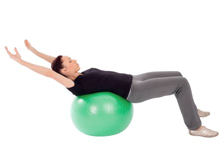 Fit woman doing abdominal stretch exercise with gym ball, isolated on white background. Stock Photo - 6358303
