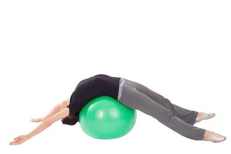 Fit woman doing abdominal stretch exercise with gym ball, isolated on white background. photo