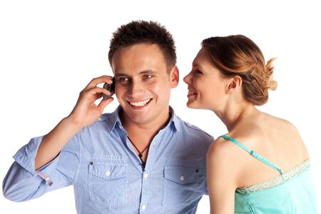 Cheerful young couple listening to the phone isolated on white background Stock Photo - 6801693