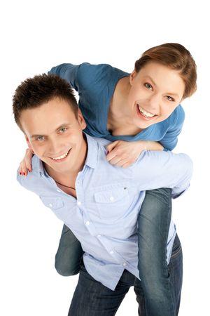 pareja apasionada: Joven y atractiva pareja feliz divertirse aislados sobre fondo blanco