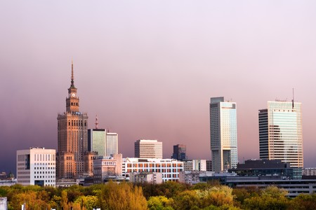 Warsaw, capital city of Poland cityscape, just before the sunset, featuring Palace of Culture and Science, Srodmiescie district. Stock Photo