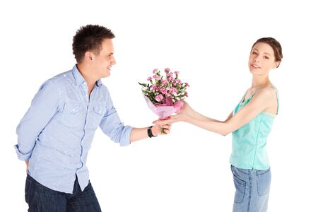 Cheerful happy casual couple isolated on white, romantic man giving flowers to his girlfriend  Stock Photo - 6965052