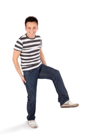 easygoing: Young happy easygoing casual man standing on one leg isolated on white background
