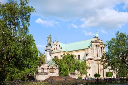 mickiewicz: 17th century Roman Catholic Carmelite Church and Adam Mickiewicz Polish Romantic poet statue in Warsaw, Poland