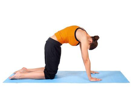 sanskrit: Fit woman doing yoga exercise called Cat Pose, sanskrit name: Viralasana, isolated over white background