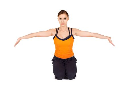 strengthening: Young attractive fit woman doing wrist strengthening exercise on white isolated background