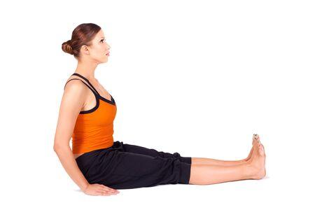 sanskrit: Fit woman doing yoga exercise called Staff Pose, sanskrit name: Dandasana isolated over white background