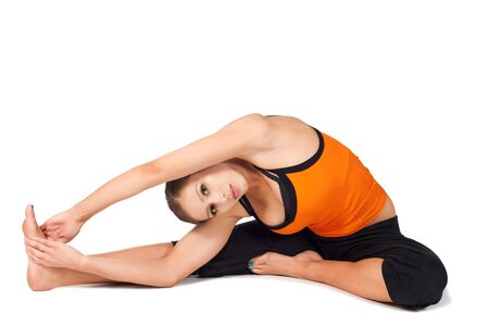 janu: Woman doing yoga exercise called Revolved Head-to-Knee Pose - stage 2, sanskrit name: Parivrtta Janu Sirasana, this pose helps with emotional calming during time of intense hormonal shifts, isolated on white Stock Photo