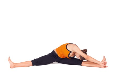 sanskrit: Woman doing yoga exercise called Side Seated Angle Pose, sanskrit name: Parsva Upavista Konasana, great pose for cyclists to stretch out hamstrings and lower back, isolated on white background