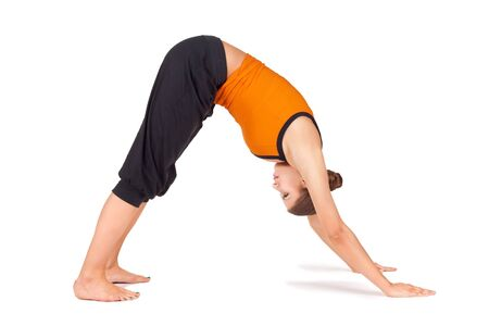 Woman doing yoga exercise called Downward Facing Dog, sanskrit name: Adho Mukha Svanasana, good pose to calms the brain, relieve stress, depression, headache, insomnia, back pain, and fatigue, stretching shoulders, hamstrings, calves, arches and hands.