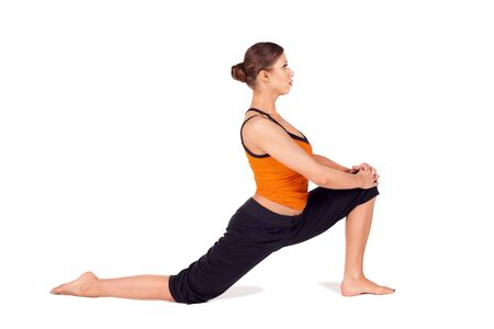 Woman practicing first stage of yoga pose called Crescent Lunge, sanskrit name: Anjaneyasana, this posture stretches the thighs, hamstrings, groins, hip, isolated on white