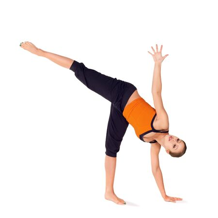 chandrasana: Woman practicing yoga exercise called Half Moon Pose, sanskrit name: Ardha Chandrasana, this pose strengthen abdomen, ankles, thighs, buttocks and spine, stretches the groins, hamstrings, calves, shoulders, chest, and spine