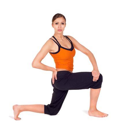 parivrtta: Woman doing first stage of yoga exercise called: Revolved Side Angle Pose, sanskrit name: Parivrtta Parsvakonasana, isolated on white
