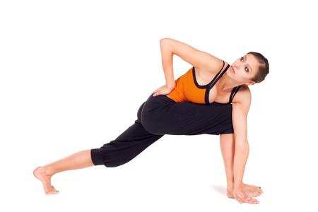 parsvakonasana: Woman doing second stage of yoga exercise called: Revolved Side Angle Pose, sanskrit name: Parivrtta Parsvakonasana, isolated on white