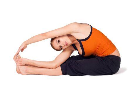 parivrtta: Young fit woman practicing yoga exercise called: Revolved Seated Forward Bend, sanskrit name: Parivrtta Paschimottanasana, isolated on white background Stock Photo