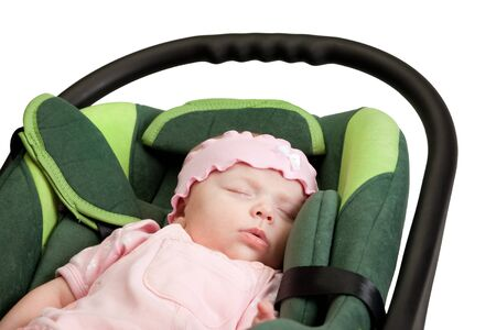 Six weeks old little baby girl in car seat isolated over white photo