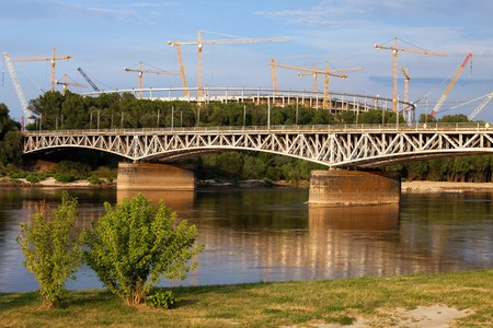 Late afternoon at Vistula river with the National Stadium under construction in the background in Warsaw, Poland. Stock Photo - 7489696