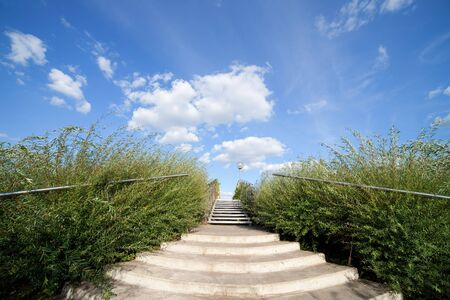 concrete stairs: Stairs to the big blue sky and clouds abstract concept Stock Photo