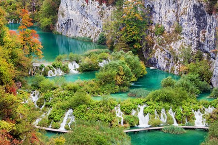 Scenic autumn landscape with numerous waterfalls, cascades and lakes photo