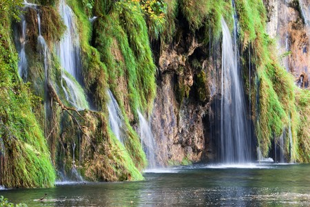 Small waterfalls in a beautiful scenery of the Plitvice Lakes National Park in Croatia photo