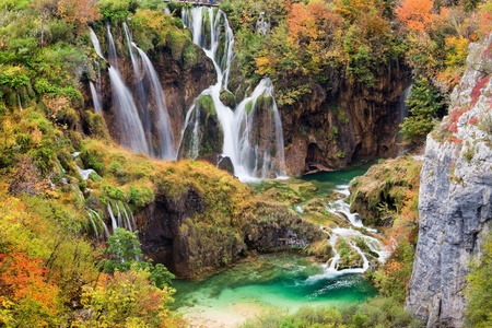 Scenic waterfalls in a beautiful picturesque autumn scenery of the Plitvice Lakes National Park in Croatia