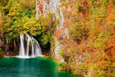 Waterfall in autumn scenery of the Plitvice Lakes National Park in Croatia photo
