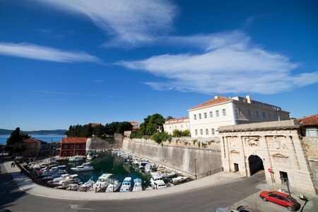 Small harbor and entrance ( Land Gate) to the city of Zadar in Croatia photo